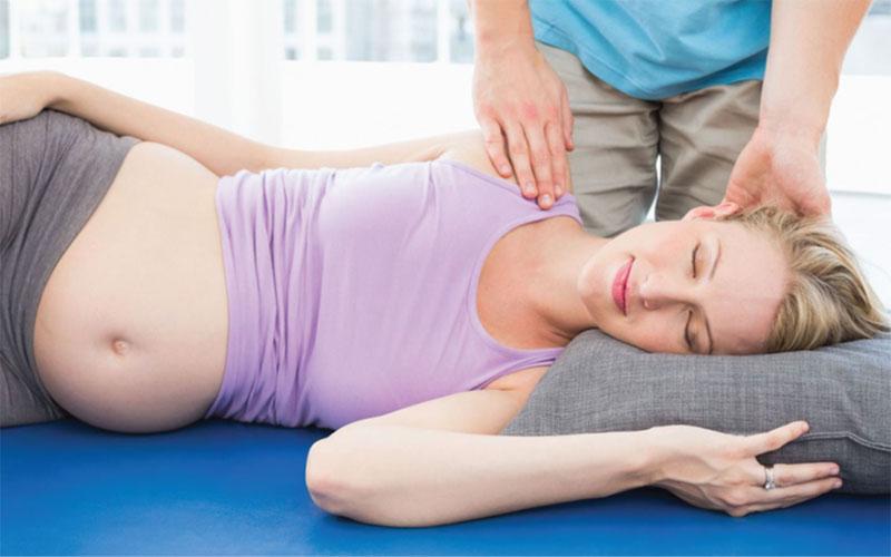Причины болей в спине при беременности